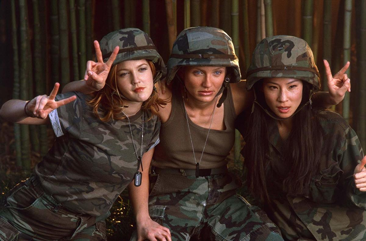 drew barrymore, cameron diaz, and lucy liu in camouflage outfits in charlie's angels