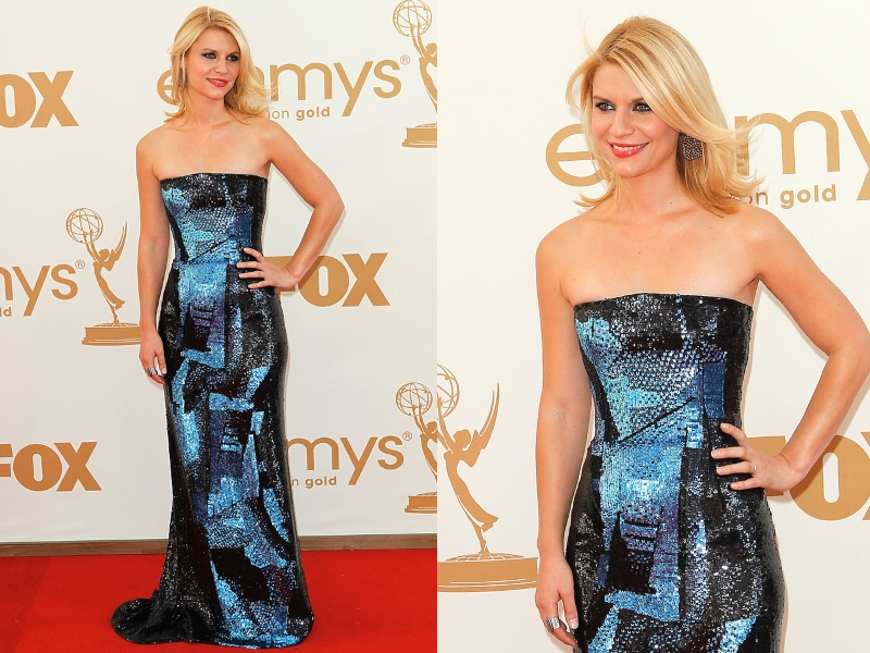 Claire Danes wears a glistening black and blue, form-fitting dress.