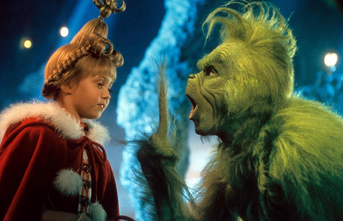 taylor momsen dressed as cindy lou who and jim carrey dressed as the grinch in how the grinch stole christmas