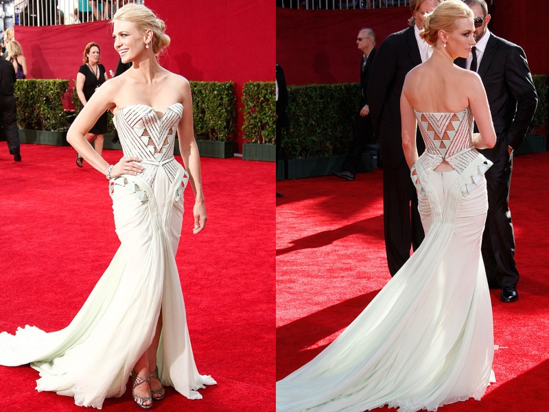 January Jones wears a strapless, off-white gown with a sinched top and flowy bottom.