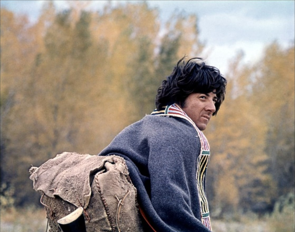 dustin hoffman walking near nature in a still from little big man