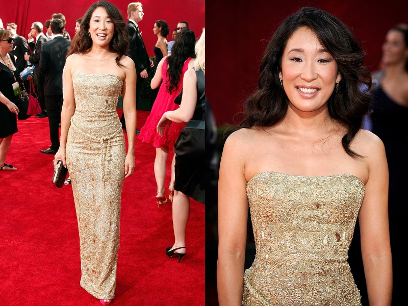 Sandra Oh wears a textured, form-fitting, soft gold gown.