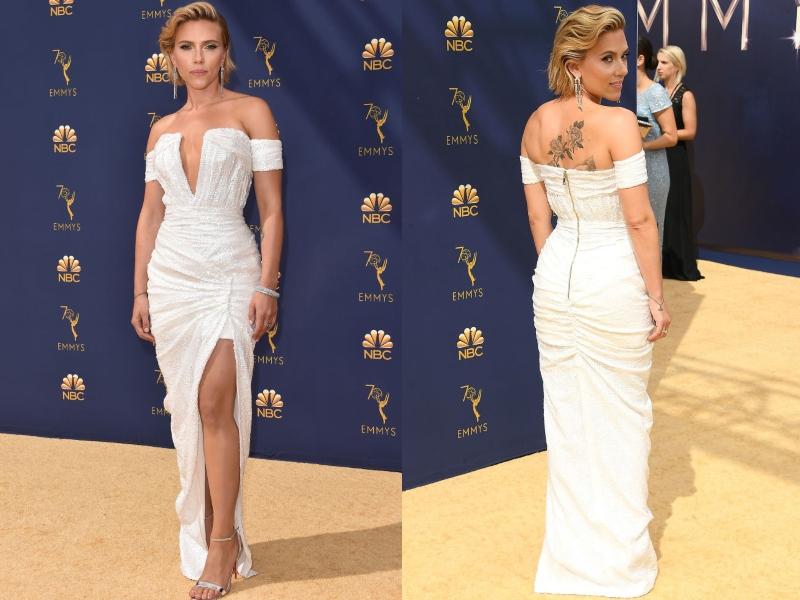 Scarlett Johanson wears a sinched, white dress.