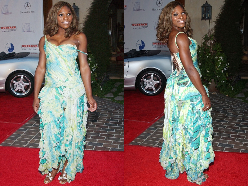 Serena Williams poses in a flowy dress at an event.