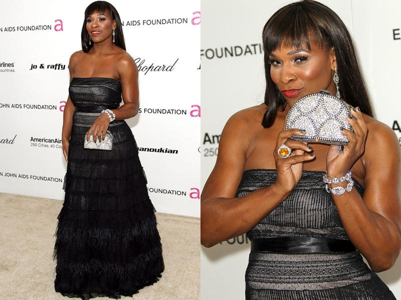 Serena shows off her jeweled clutch while wearing a black gown.