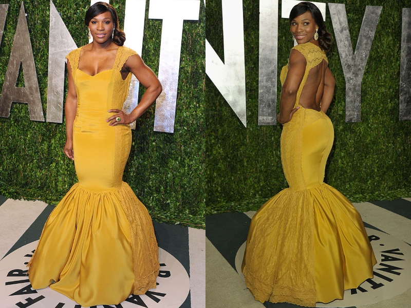 Serena wears a form-fitting, yellow gown at a Vanity Fair event.