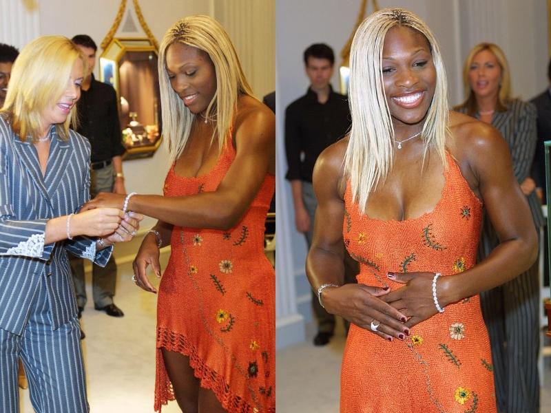 Serena Williams have bleach blonde hair and an orange dress on while wearing a prestigous diamond bracelet.