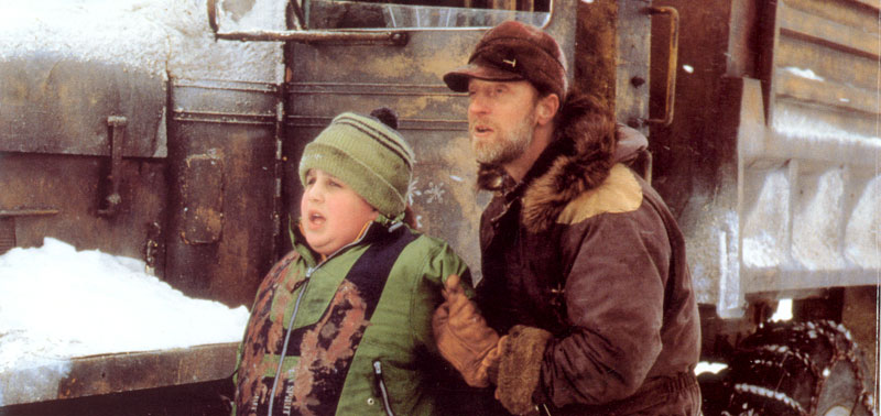 josh peck and chris elliott standing by a snow plow truck in snow day
