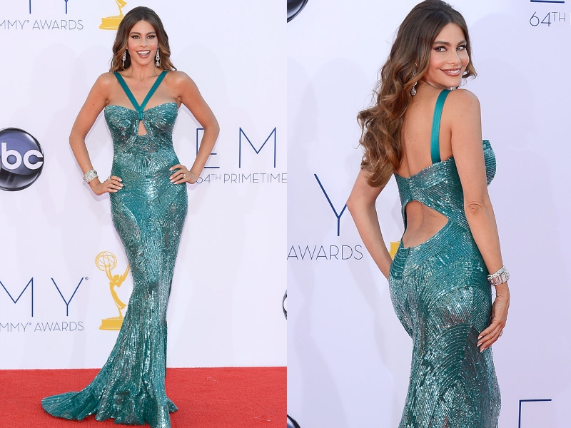 Sofia Vergara poses in her form-fitting, sparkly, teal dress.