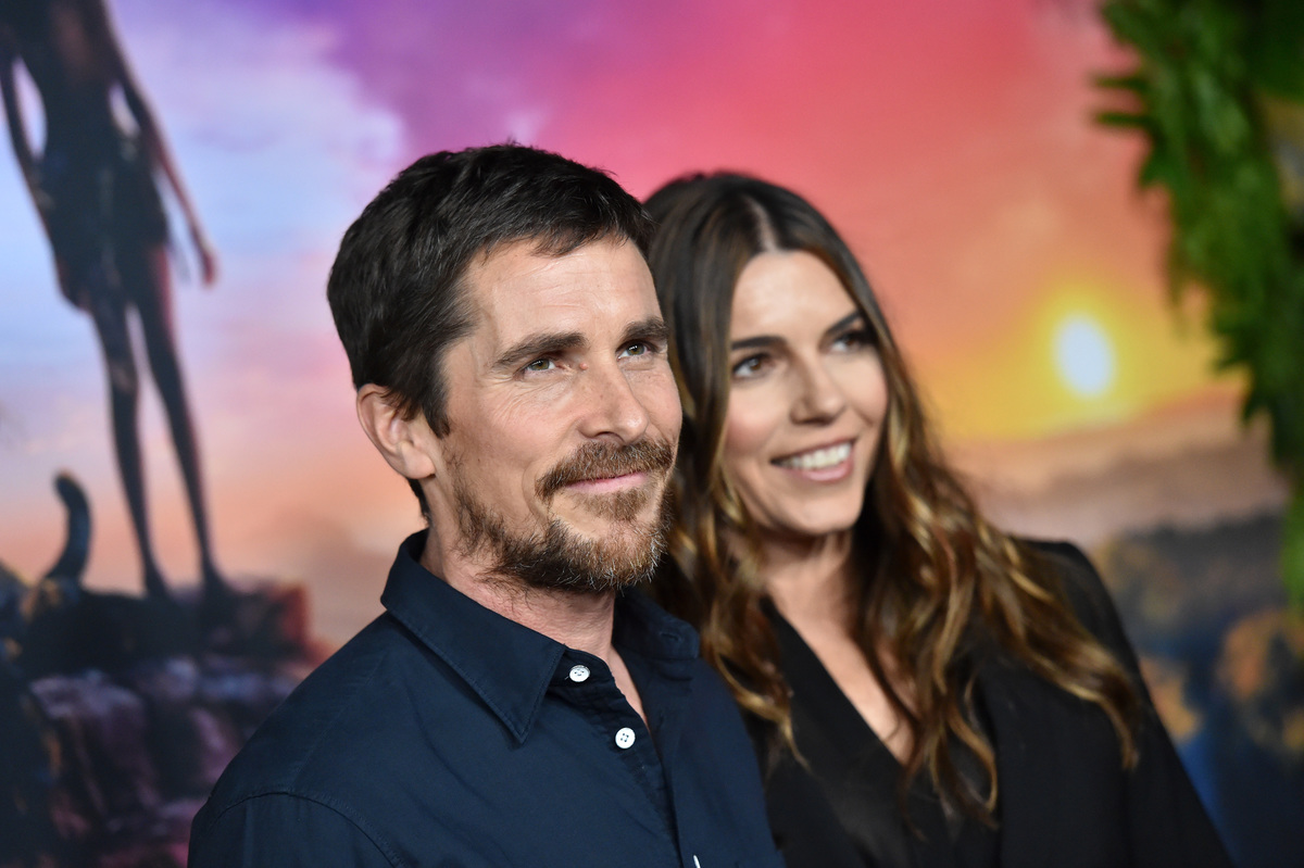 Christian Bale and Sibi Blazic attend the premiere of Netflix's 'Mowgli'.