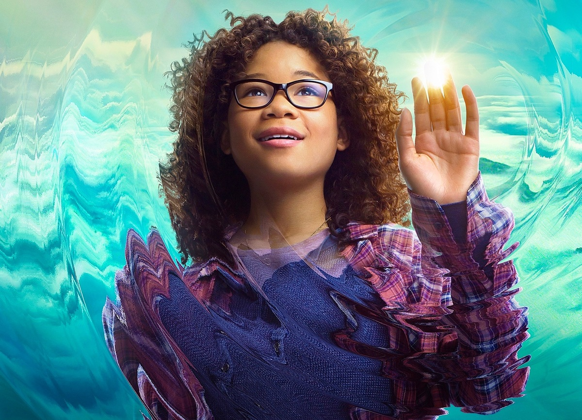 a girl with glasses touching a ball of light in a wrinkle in time