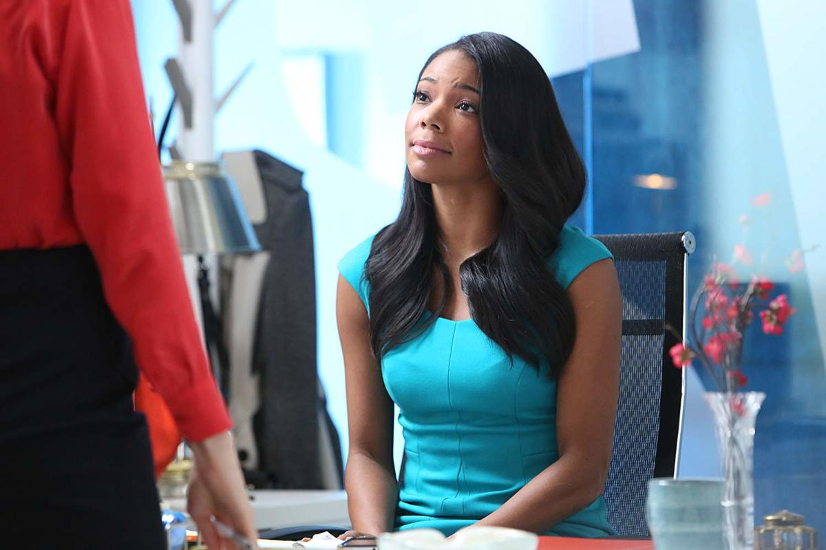 gabrielle union in a blue dress in being mary jane