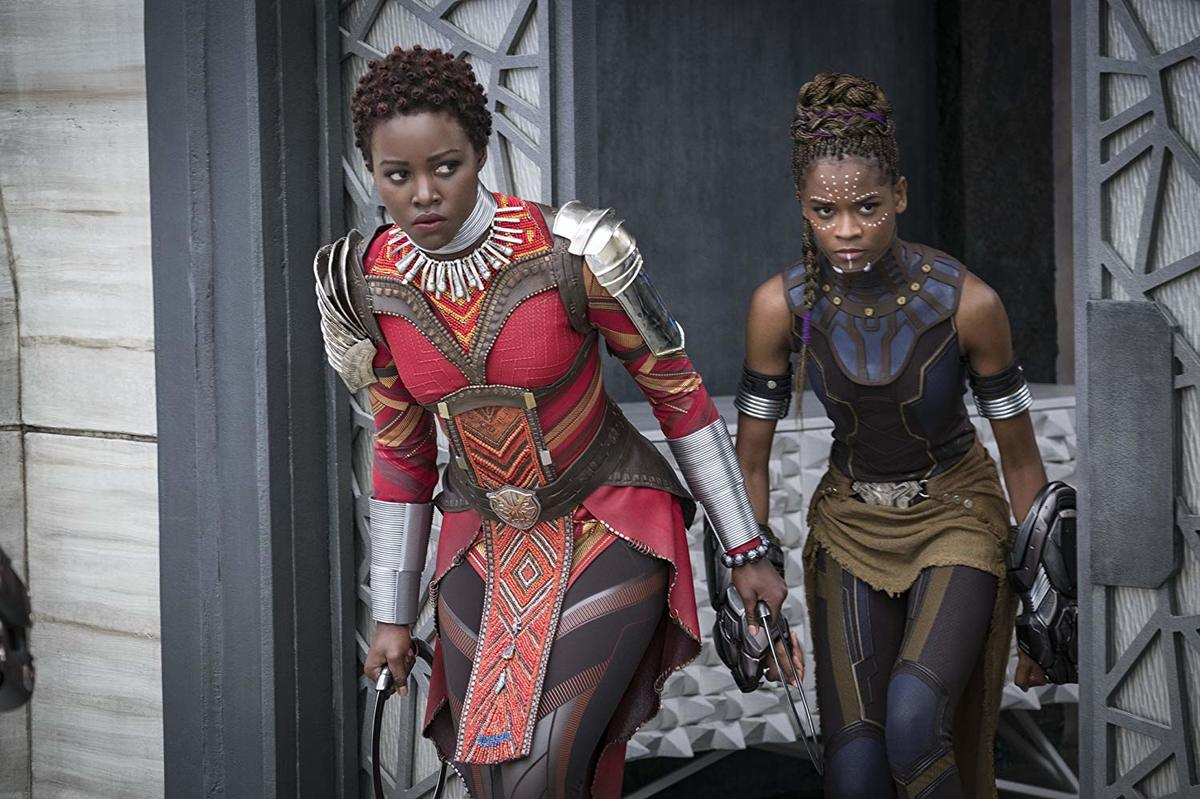 lupita nyong'o and letitia wright in costumes in black panther