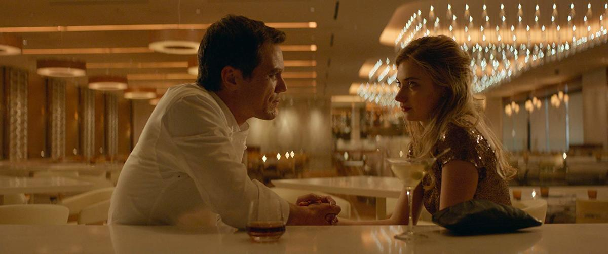 michael shannon and imogen poots sitting at a bar