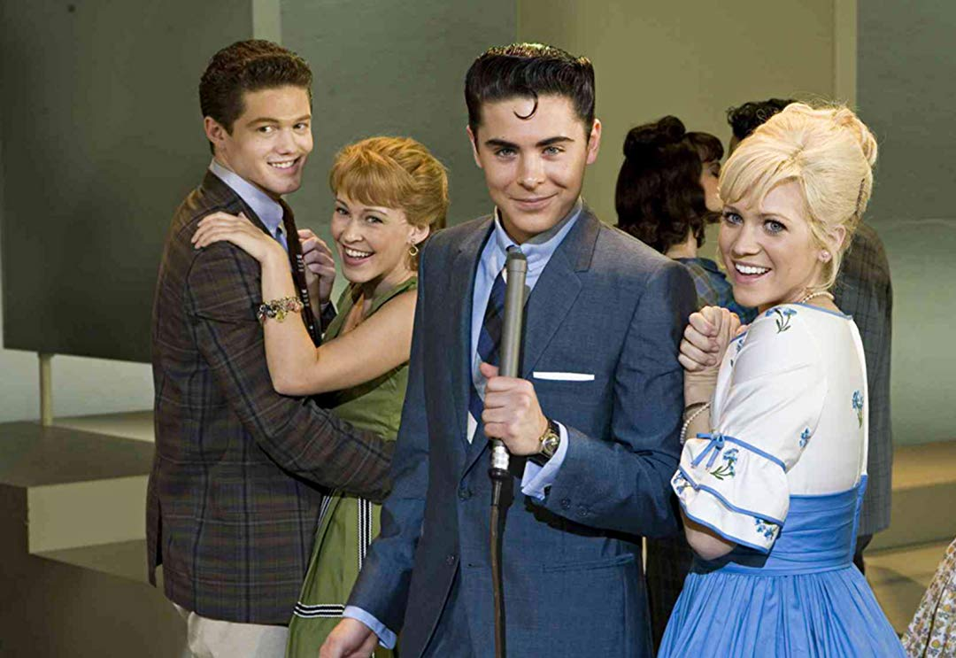 zac efron and brittany snow dressed in 1960s clothes in hairspray