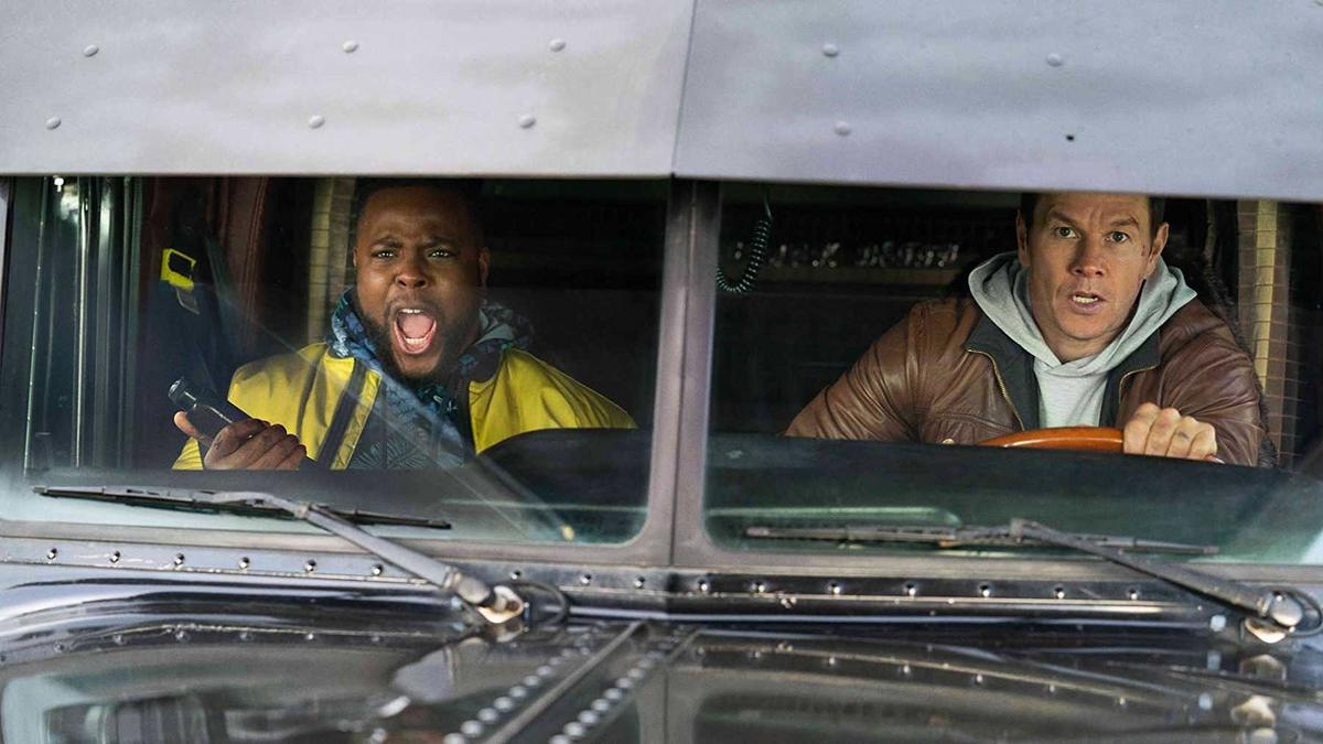 winston duke and mark wahlberg driving in a truck in spenser confidential