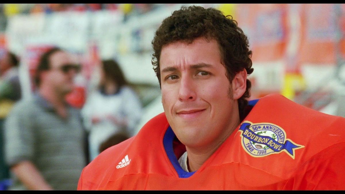 adam sandler wearing a football jersey in the waterboy