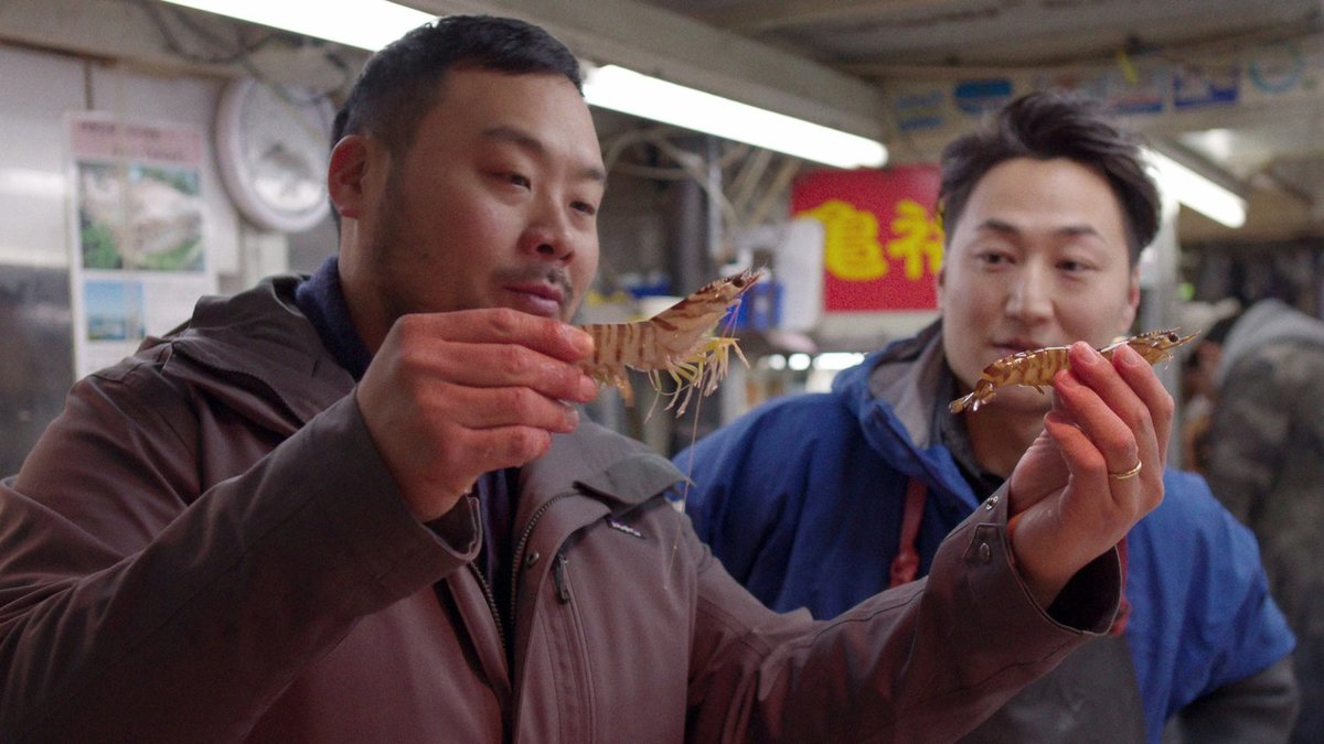 david chang and friend with crawfish in ugly delicious