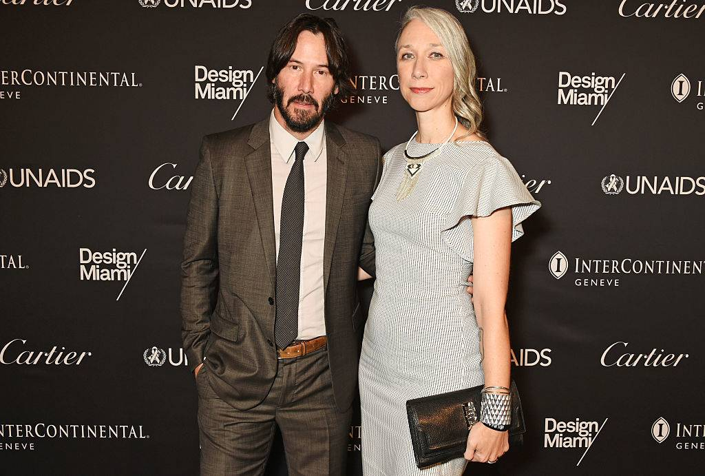 Keanu Reeves (L) and artist Alexandra Grant attend the UNAIDS Gala