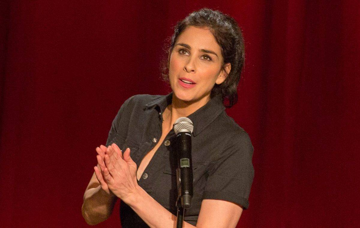 sarah silverman clapping her hands in front of a microphone