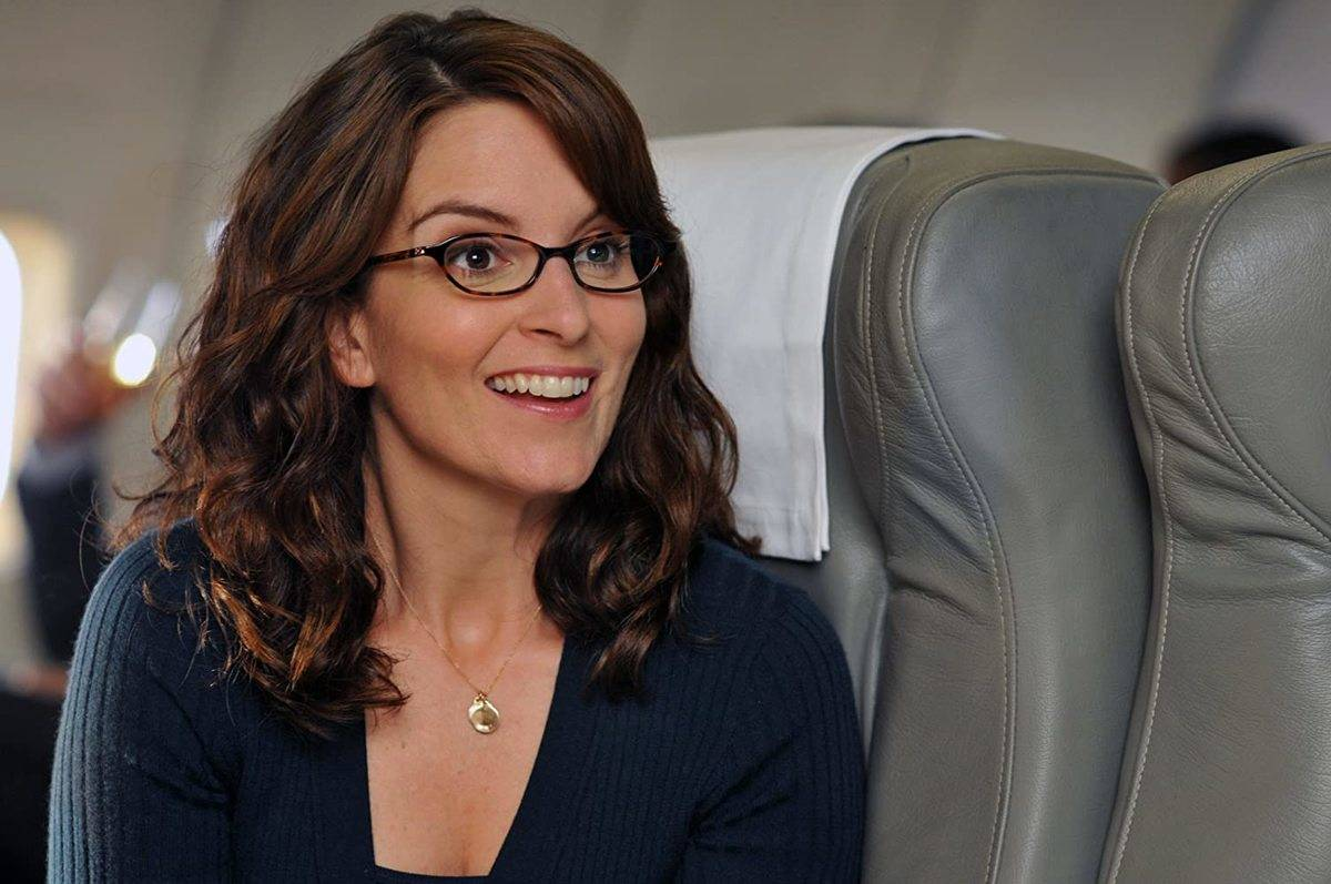 tina fey sitting on an airplane in 30 rock