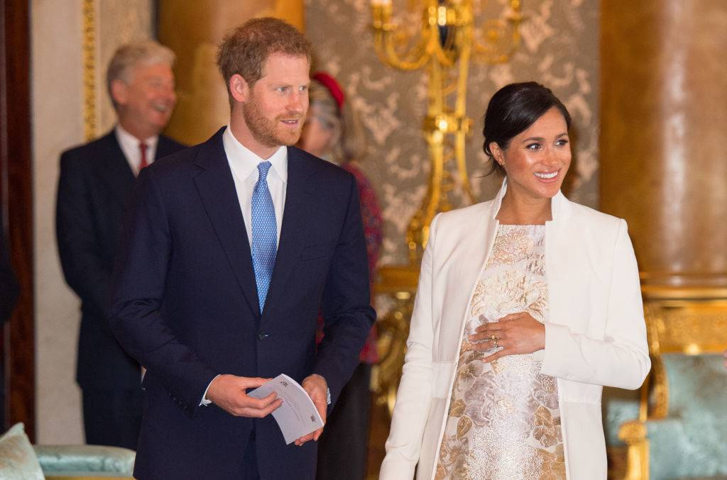 Britain's Prince Harry, Duke of Sussex, (L) and Britain's Meghan, Duchess of Sussex (R) attend a reception to mark the 50th Anniversary of the investiture of The Prince of Wales at Buckingham Palace