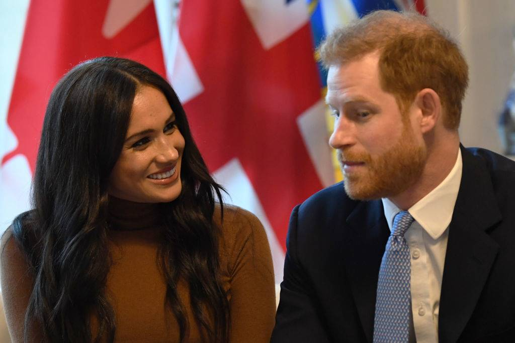 Prince Harry, Duke of Sussex and Meghan, Duchess of Sussex gesture during their visit to Canada House in thanks for the warm Canadian hospitality