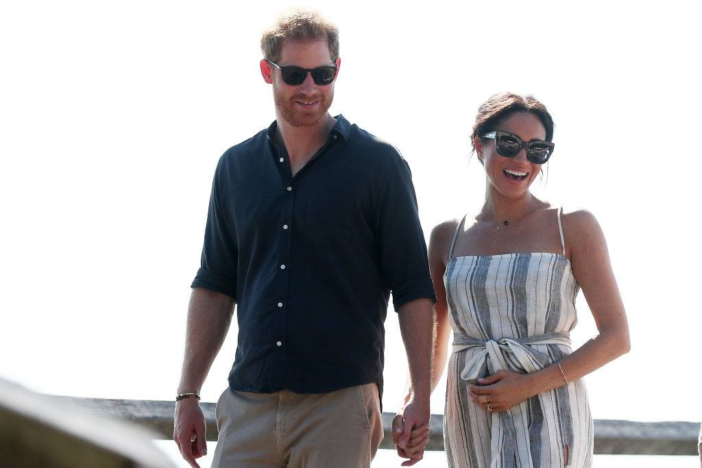 Prince Harry, Duke of Sussex and Meghan, Duchess of Sussex walking along Kingfisher bay