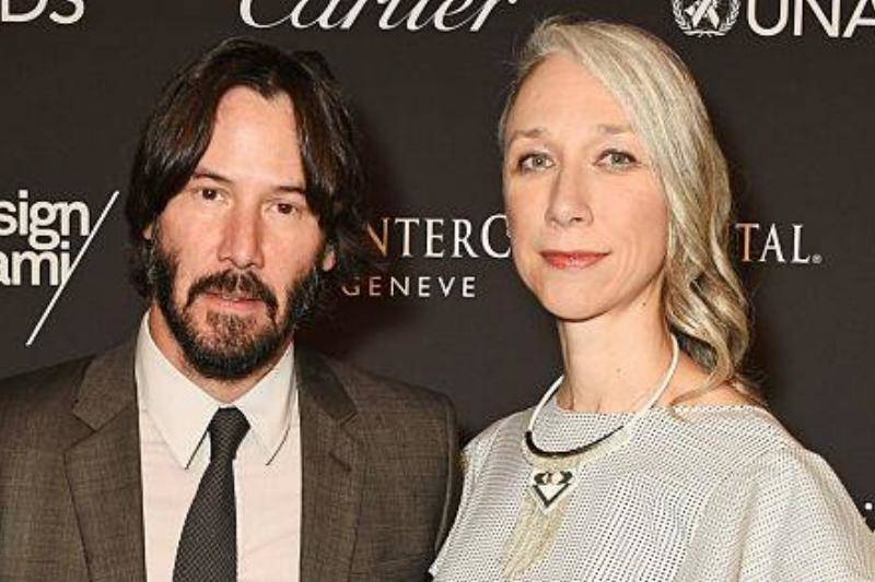 Keanu Reeves (L) and artist Alexandra Grant attend the UNAIDS Gala