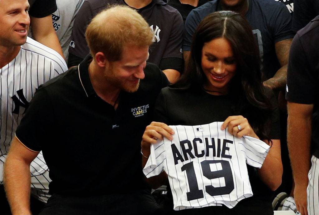 Prince Harry, Duke of Sussex and Meghan, Duchess of Sussex with a gift from the New York Yankees