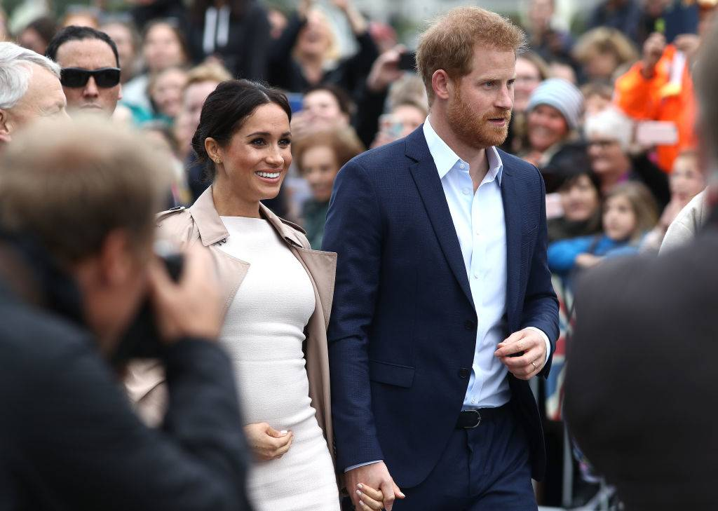 Prince Harry, Duke of Sussex and Meghan, Duchess of Sussex take part in a Public Walkabout at Viaduct Harbour