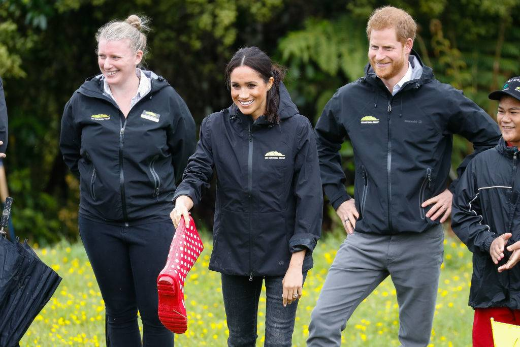 Prince Harry, Duke of Sussex and Meghan, Duchess of Sussex playing a game of 'Welly Wanging'