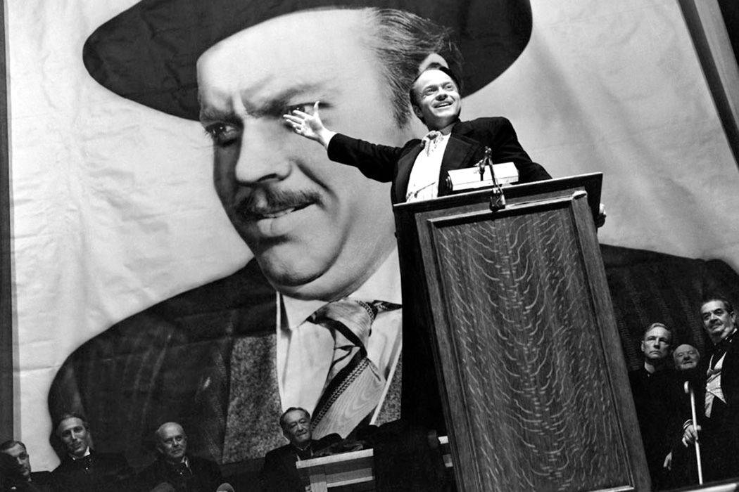 orson welles standing at a podium
