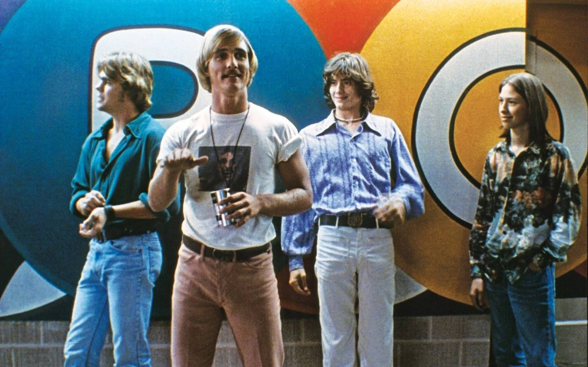 matthew mcconaughey and other boys standing against a wall