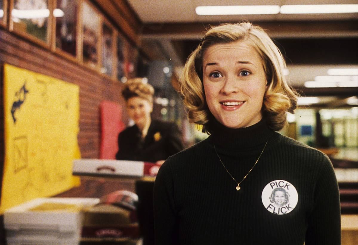 reese witherspoon wearing a button that says