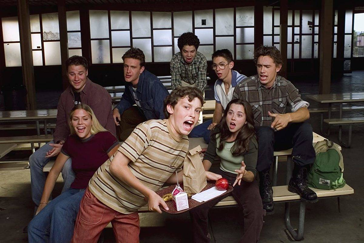 cast of freaks and geeks at a lunch table