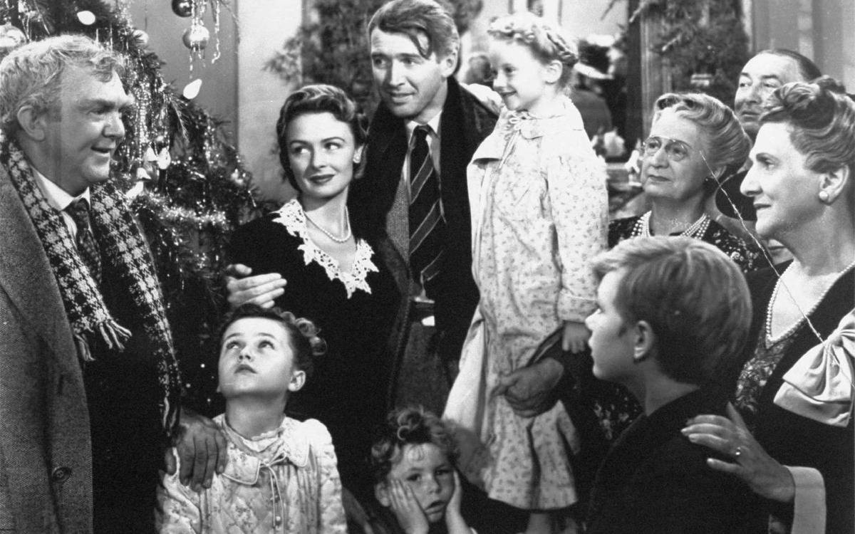 the cast of it's a wonderful life in a black and white still from the movie
