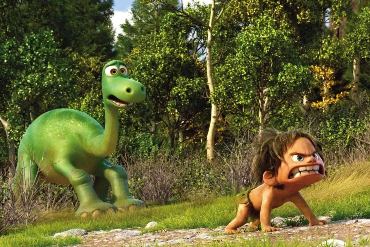a cartoon green dinosaur and a caveman child