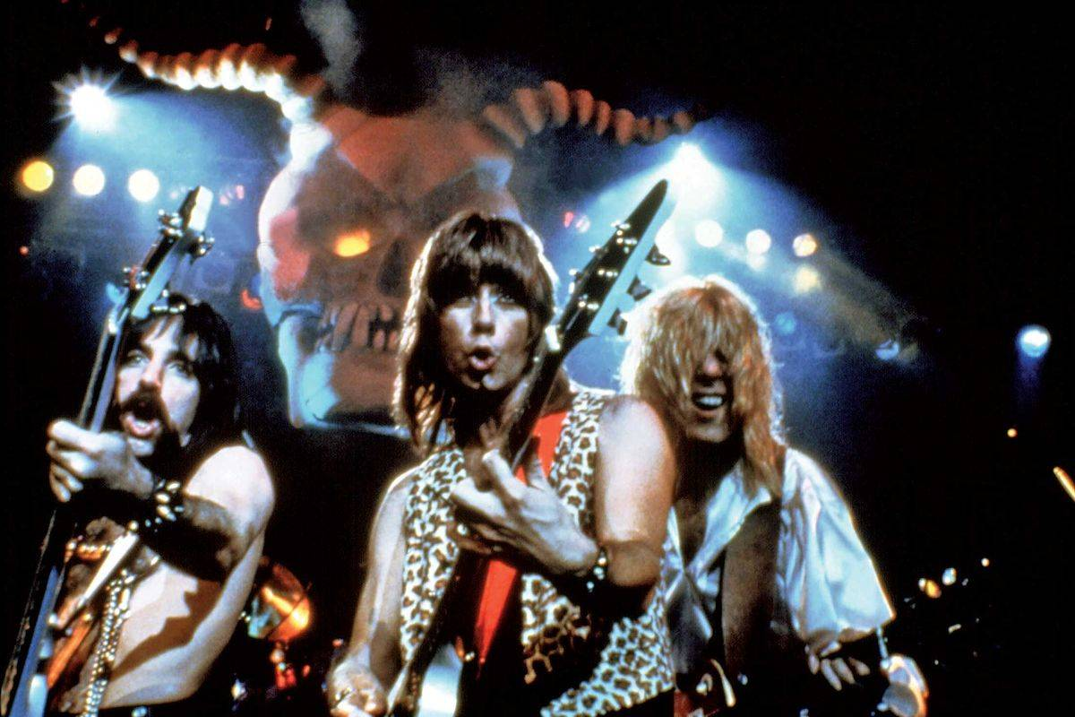 cast of this is spinal tap playing guitars