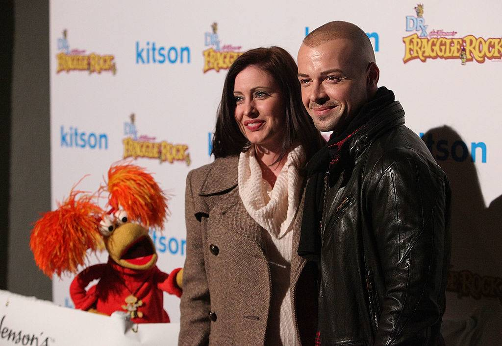 joey lawrence and chandie yawn-nelson posing on the red carpet