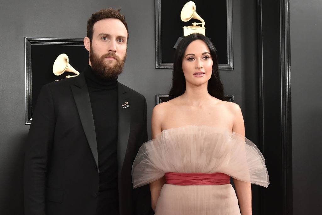 kacey musgraves and ruston kelly on a red carpet