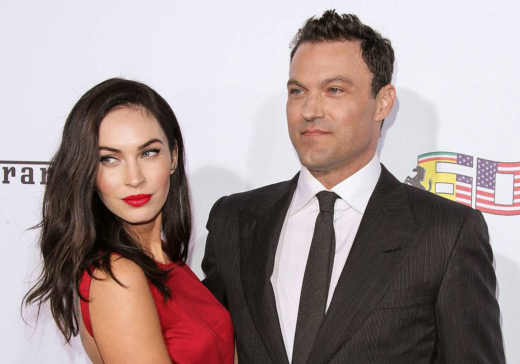 megan fox and brian austin green on a red carpet