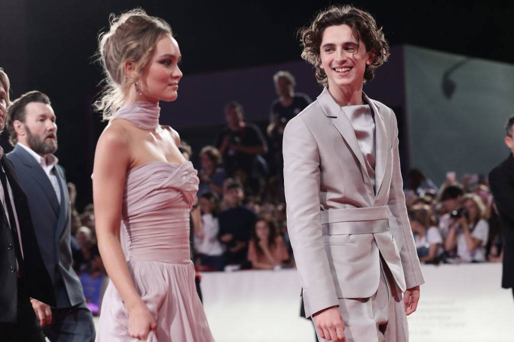 timothee chalamet and lily-rose depp dressed up for a movie premiere