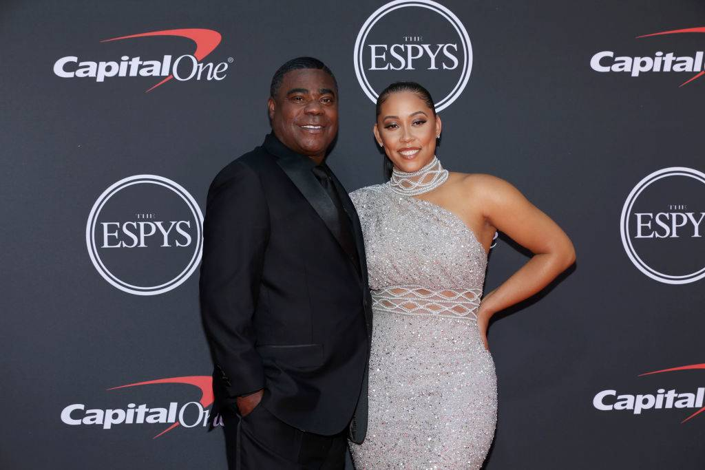 tracy morgan and megan wollover on a red carpet