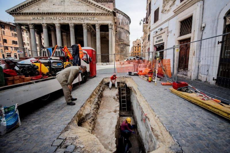 Man looking into sinkhole
