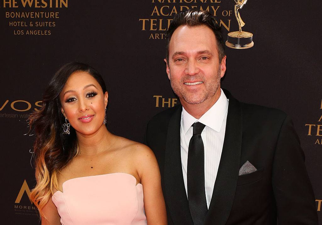 Tamera Mowry-Housley and Adam Housley at an event in 2016