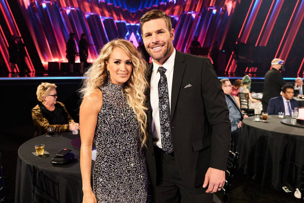 Carrie Underwood and Mike Fisher attending an event in 2020