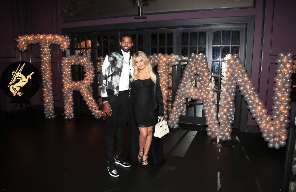 Tristan Thompson and Khloe Kardashian pose for a photo in 2018