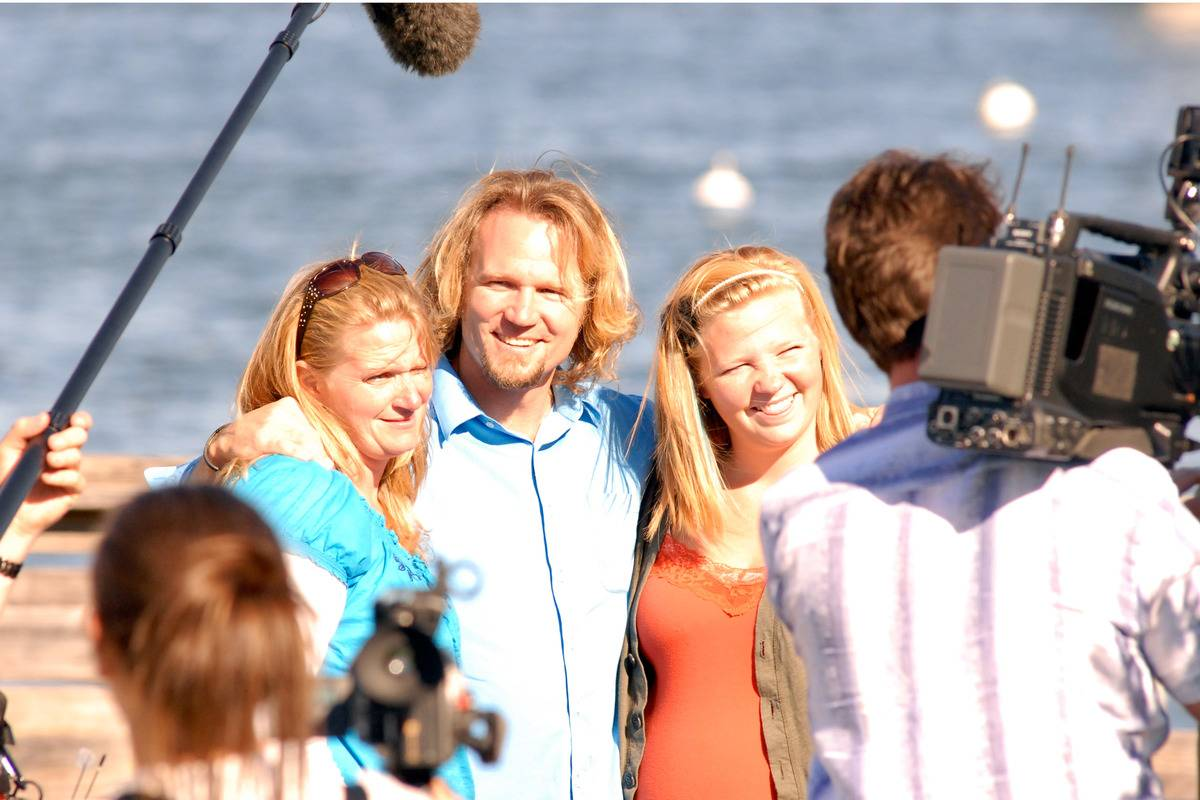 Kody Brown and his wife and daughter film Sister Wives on Plymouth Beach.