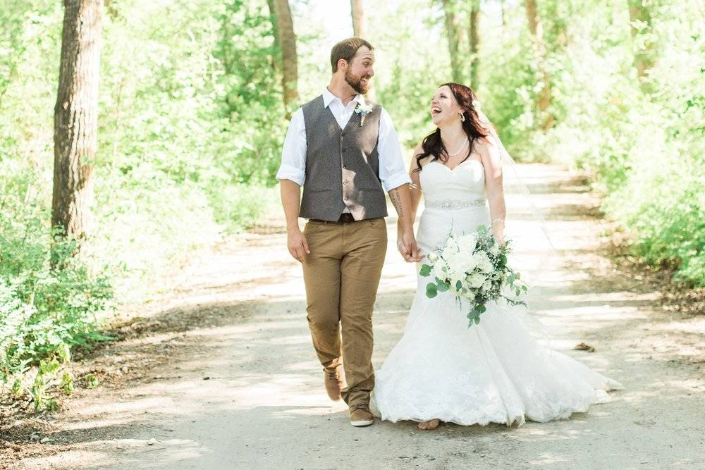Maddie and Caleb walk and chat on their wedding day.